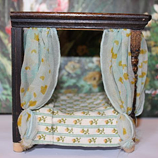 "Small Doll house canopy bed, wood with drapes on each side, bedding 5 3/4"" tall X 5"" long X 4"" deep in size. Good for 4 1/2"" tall doll, not included."