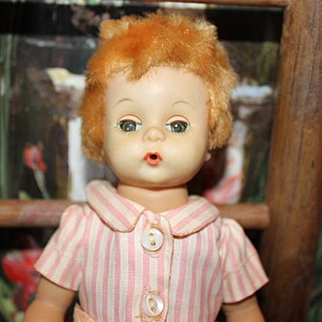 "1959 Madame Alexander hard plastic Little Genius Vintage doll, baby, has original tagged shorts on, shirt is a replacement. 7"" tall, soft mohair,caracul wig."