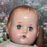 """Vintage baby doll, unmarked, badly flaking on legs and arms. 15"""" tall in size,  age spots on body, hard plastic head. Priced to sell!"""