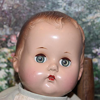 "Vintage baby doll, unmarked, badly flaking on legs and arms. 15"" tall in size,  age spots on body, hard plastic head. Priced to sell!"