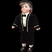 "Cute 15"" Schoenau and Hoffmeister boy in all antique costume"