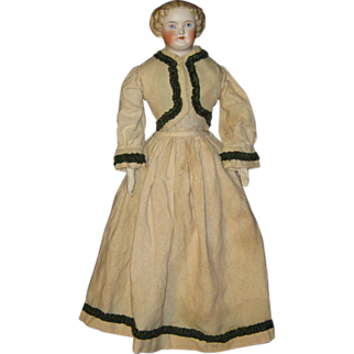 Antique Parian China  doll in fine wool costume