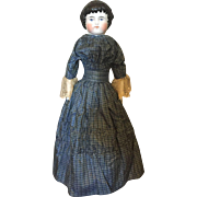 Sweet highland Mary China doll in plaid antique dress