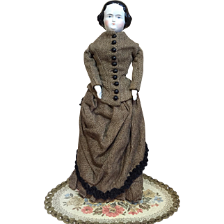 Antique china lady in wool bustle dress