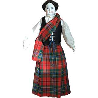 Large antique china lady in  scottish attire