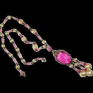 A vintage 1930's Czech pink glass lavalier necklace