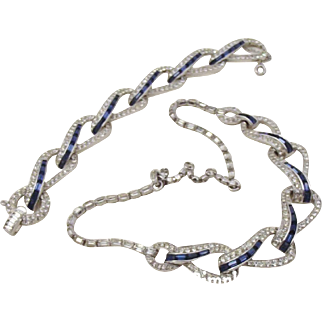 Marcel Boucher clear and sapphire rhinestone crossover necklace and bracelet set.