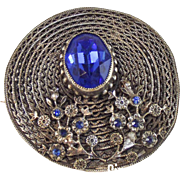 Vintage 1920's silver metal Art Deco Ceylon Sapphire Rhinestone Brooch, Hat or Kilt Pin which takes the form of a straw hat