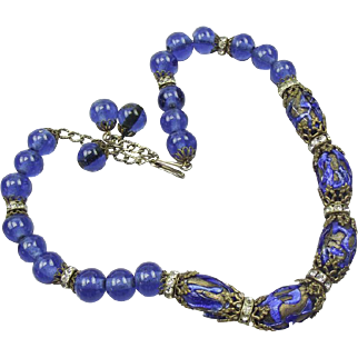 Venetian electric blue poured glass bead and foiled bead necklace.