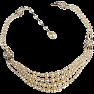 Louis Rousselet four row glass pearl festoon necklace