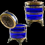 "6""H Antique Royal blue, cobalt glass trinket Box, hinged lid w/ bronze figurines"
