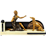 French Art Deco composition figurine of a Lady with dog on marble base