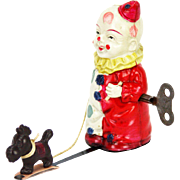 Vintage Wind Up Celluloid Clown Walking a Dog ca1920