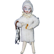 Antique German Cotton Batting and Bisque Doll Head Ice Skater Ornament ca1910
