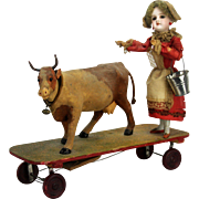 Antique German Mechanical Automation Bisque Girl with Cow Pull Toy ca1910