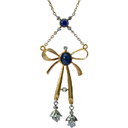 Antique knot/bow necklace diamonds natural sapphires 18 k yellow gold and platinum circa 1915
