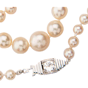 Pearls necklace 0.50 ct diamond H-I / VS Art Deco clasp circa 1930