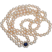 Vintage double strands Akoya cultivated pearls 7 mm average diameter Sapphire and pearls 18 karat white gold clasp circa 1960-70