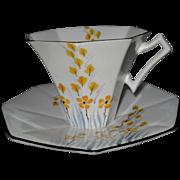 Melba Art Deco Shape Yellow Floral Teacup and Saucer