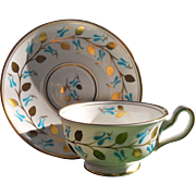 Cheerful Royal Chelsea Turquoise and Gold Teacup and Saucer