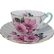 Shelley Ludlow Pink Wild Roses Teacup and Saucer Turquoise Handle