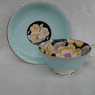 Stunning Paragon Royal Warrant Pansy on Black with Blue Teacup and Saucer