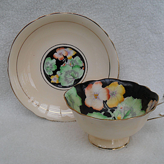 Stunning Paragon DW Geraniums on Black with Peach Teacup and Saucer