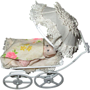 Vintage baby doll and carriage