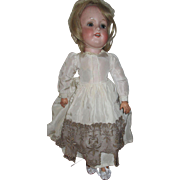 Antique Armand Marseille 390 Doll with Heinrich composition body.