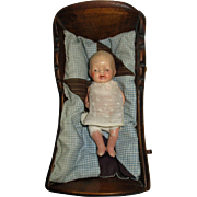 Vintage Wooden Doll Cradle with Bisque Baby