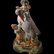 Antique Bisque Children On a Bird Figure