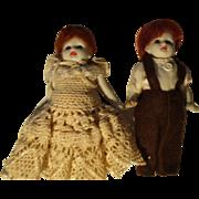 Pair of German Vintage Bisque Boy and Girl Dolls
