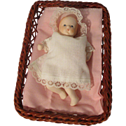 Vintage Baby Doll in Wicker Basket