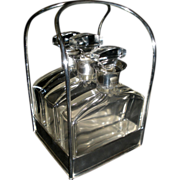 Hallmarked English Silver Tantalus with Sterling collared hand formed decanters