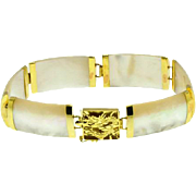 Mother of pearl station bracelet in 14kt yellow gold with a stunning dragon cut out lock,