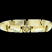 Mother of pearl 8 station bracelet in 10kt gold