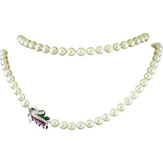 Vintage Double Strand Akoya Pearl Necklace with Intriguing 14 k Gold and Gemstones Closure.