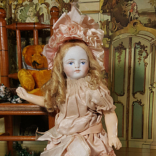 Early tiny size all original painted face doll for the french market
