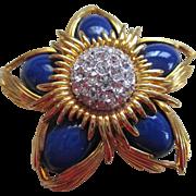 Joan River Gold tone/Rhinestone studded Star/Flower Brooch