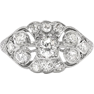 Edwardian Diamond Engagement Ring .63ct t.w. Circa 1910's Old European Cut Floral Filigree Platinum Engagement Ring