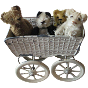 Antique tiny teds with a Steiff