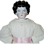 Huge German China Head Doll with Red Stockings and Leather Sewn on Boots