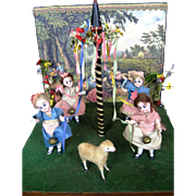 Four German All Bisque Mignonette Dolls Dancing Around the Maypole Antique Presentation