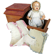 Small Celluloid Baby Doll with Cradle and Extra Clothing