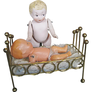 All Bisque Side-glancing Googly Doll and Germany Baby Doll in Bed