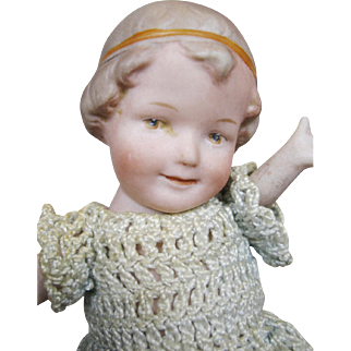 Antique All Bisque Coquette Doll With Molded Hair and Headband