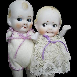 Adorable Pair of Antique Bisque Googly Eye Kewpie Dolls