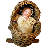 Bisque Head Small German Baby Doll in Cradle
