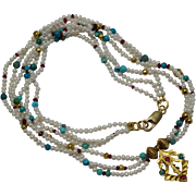 Multi Strand cultured Pearl Necklace with Turquoise, Ruby, Gold Wax Beads and a 22 karat Gold Pendant