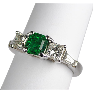 Modern Emerald .82 carats and Diamond Ring